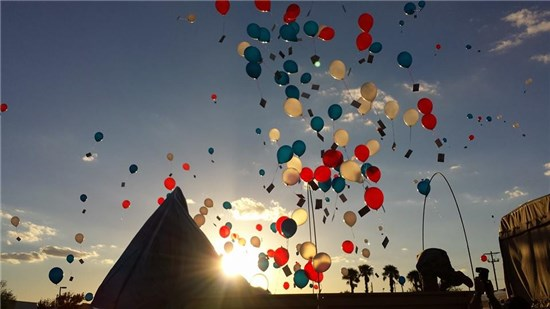 Soldiers and family members of the 436th Chemical Company, Texas Army National Guard, released 1,000 balloons in honor of five of their fallen soldiers during a ceremony held at the National Guard armory in Laredo, Texas,
