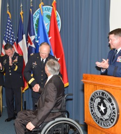 Brig. Gen. Flynn received his new badges of rank from both Governor Greg Abbott and his family