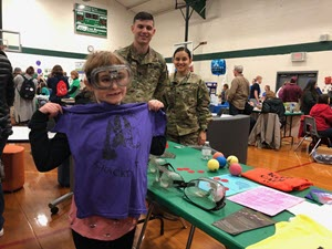 -A student of Burnet Middle School holds a Texas National Guard Counterdrug Task Force t-shirt