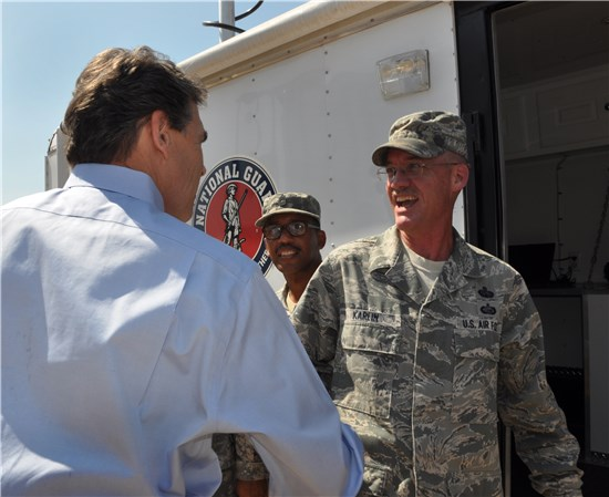 Texas Governor Rick Perry visits with Senior Master Sgt. Jonathan Karlin of Joint Force Headquarters J6, Friday, June 1, 2012 during the Texas Department of Emergency Management State Response Activation Exercise at the South Terminal of Austin Bergstrom International Airport. The Texas Military Forces was just one of the many state agencies and partners showcasing their capabilities to the Governor and other statewide leaders in preparation of the 2012 Hurricane Season.