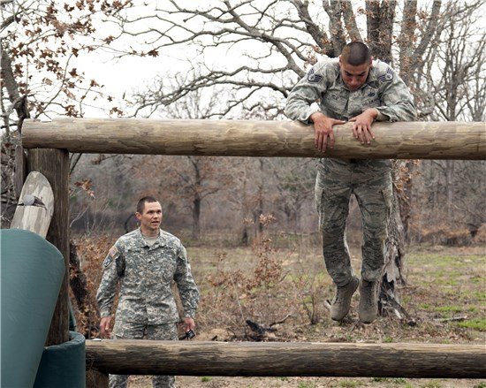 Air Force Staff Sgt. Jose Veliz, a member of the Texas Air National Guard's 149th Security Forces Squadron at Joint Base San Antonio - Lackland, attempts to negotiate an obstacle during the Texas Military Forces' Best Warrior Competition at Camp Swift, near Bastrop, Texas, Feb. 9, 2013.