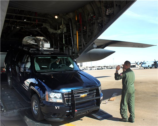 Members of the National Guard's 6th Weapons of Mass Destruction Civil Support Team, headquartered at Camp Mabry, in Austin, Texas, and members of the Texas Air National Guard's 136th Airlift Wing, headquartered at Naval Air Station Fort Worth Joint Reserve Base, Texas, load a military vehicle onto a C-130 Hercules, assigned to the 136th Airlift Wing, at NAS Fort Worth JRB, Dec. 5, 2012.