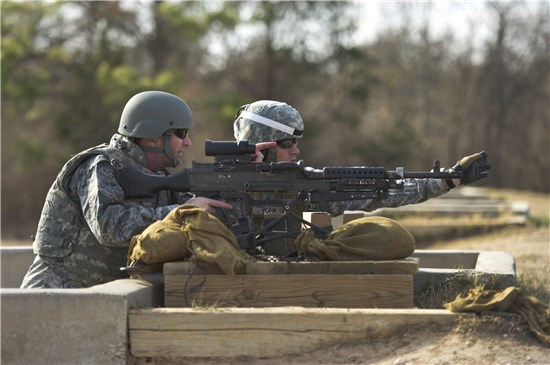 Air Force Lt. Gen. Joseph L. Lengyel, vice chief of the National Guard Bureau, receives training from Sgt. 1st Class Kyle York, a member of the Texas Army National Guard, on a M249 Squad Automatic Weapon during a visit to Camp Swift, near Bastrop, Texas, Jan. 23, 2013.