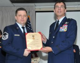 Master Sgt. Joseph G. Ashwood, from the 111th Reconnaissance Squadron, 147th Reconnaissance at Ellington Field in Houston, receives an award from Maj. Gen. Kenneth Wisian, Texas Air National Guard commander, during the 2014 Outstanding Airman of the Year  event at Camp Mabry.