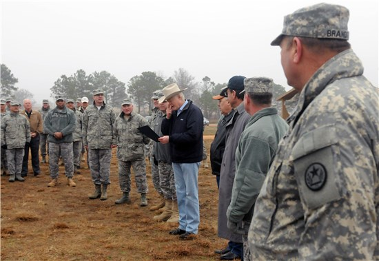 Bastrop County Judge Paul Pape reads a proclamation recognizing the soldiers and airmen competing in the Texas National Guard Best Warrior Competition at Camp Swift, Bastrop, Texas, on Saturday, Feb. 8, 2014.