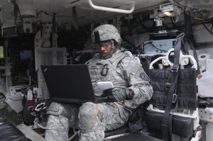 Photo of soldier on laptop