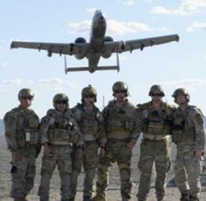 1st Lt. Alicia Lacy Tactical air control party members with the 147th Air Support Operations Squadron, 147th Reconnaissance Wing, pose as a 357th Fighter Squadron A-10 Warthog from Davis Monthan Air Force Base, Arizona, flies overhead April 12, 2016. The battlefield airmen traveled to the desert range in Gila Bend for a weeklong simulated deployment with their Czech partners. (U.S. Air National Guard photo by 1st Lt. Alicia Lacy/Released)