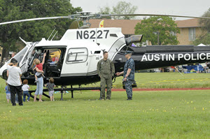 Spectators check out an Austin Police Department helicopter during the 10th annual Texas Military Department's Open House featuring the American Heroe's Air Show. The event showcases the Texas Military Department and various state and local law enforcement agencies, first responders, volunteer services and veteran support organizations at Camp Mabry in Austin, Saturday, April 16, 2016. The free two day event featured the Traveling Vietnam Wall, a naturalization ceremony for members of all military branches, World War II and Vietnam reenactments, the Missing in America Project, local first responder demonstrations, a JROTC Drill competition and numerous vendors.(U.S. Army National Guard photo by Spc. Christina Clardy/Released)