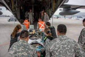 Senior Master Sgt. Elizabeth Gilbert Critical Care Air Transport teams from the U.S. Air Force and Aerea Fuerza de Chile, load a mock patient onboard a C-130H2 aircraft belonging to the 136th Airlift Wing, Texas Air National Guard, during a medical air-evacuation exercise at Santiago, Chile, April 5, 2016. The one day exercise involved Texas and Oklahoma Air National Guardsman, Active duty USAF and Chilean air force medical teams as they collaborate and exchange techniques for domestic operations during natural disasters. (U.S. Air National Guard photo by Senior Master Sgt. Elizabeth Gilbert/released)