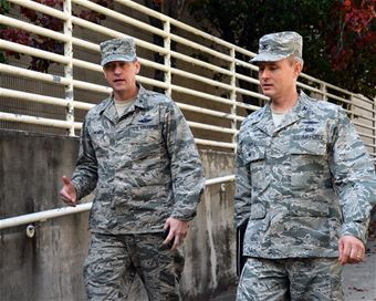 Brig. Gen. David McMinn, Texas Air National Guard commander, talks to Col. Michael Lovell, Air National Guard advisor to the 25th Air Force, while attending a newly implemented cyber course Dec. 10 in San Antonio. The course, which was the first of its kind, spanned four days and familiarized National Guard senior leaders with the threats and resources available in the cyber realm.