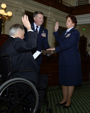 Texas Gov. Greg Abbott administers the oath of office to Brig. Gen. Dawn M. Ferrell during her promotion ceremony Jan. 15, 2016, in the Texas Capitol's Senate Chambers. Abbott appointed Ferrell as the Deputy Adjutant General - Air for the Texas Military Department's Texas Air National Guard. Ferrell is the first female to hold the rank of general officer in the TXANG. (Air National Guard photo by 1st Lt. Alicia Lacy/Released)
