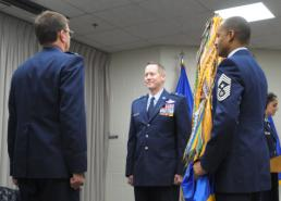 2nd Lt. Phil Fountain Brig. Gen. David M. McMinn (center), chief of staff of the Texas Air National Guard, prepares to receive the organization's flag in a ceremony recognizing the change of command from Maj. Gen. Kenneth W. Wisian (left) to McMinn during a ceremony at Camp Mabry, in Austin, Texas, Jan. 23, 2016. Command Chief Master Sgt. Marlon Nation, the command chief master sergeant of the Texas Air National Guard, holds the flag prior to the change of command ceremony. (U.S. Air National Guard photo by 2nd Lt. Phil Fountain / Released)