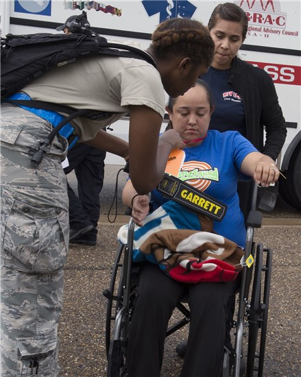 An Air Force medic searches mock patients for harmful objects as they are brough into from local medical facilities during a state-level Hurricane evacuation exercise June 09, 2016, at the Valley International Airport, Harlingen, Texas. Any weapons found are given over to the security forces officers from the 149th Security Forces Squadron. (Photo by: U.S. Army National Guard Sgt. Elizabeth Pena)