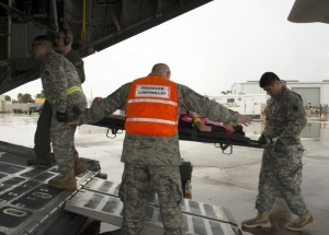 Photo By Sgt. Elizabeth Pena | An Air Guardsman evaluates Texas Guardsmen on their transport of mock patients to the military aircraft during an evacuation exercise at the Valley International Airport in Harlingen, Texas, June 9, 2016. The Texas Division of Emergency Management along with the support of Texas Military Department and other state and local authorities conduct a state level hurricane-preparedness exercise June 1-9, 2016 across various Texas cities. The Texas Military Department practiced both general population and medical evacuation through embarkation hubs in the Rio Grande Valley. (Photo by U.S. Army National Guard Sgt. Elizabeth Pena/Released)