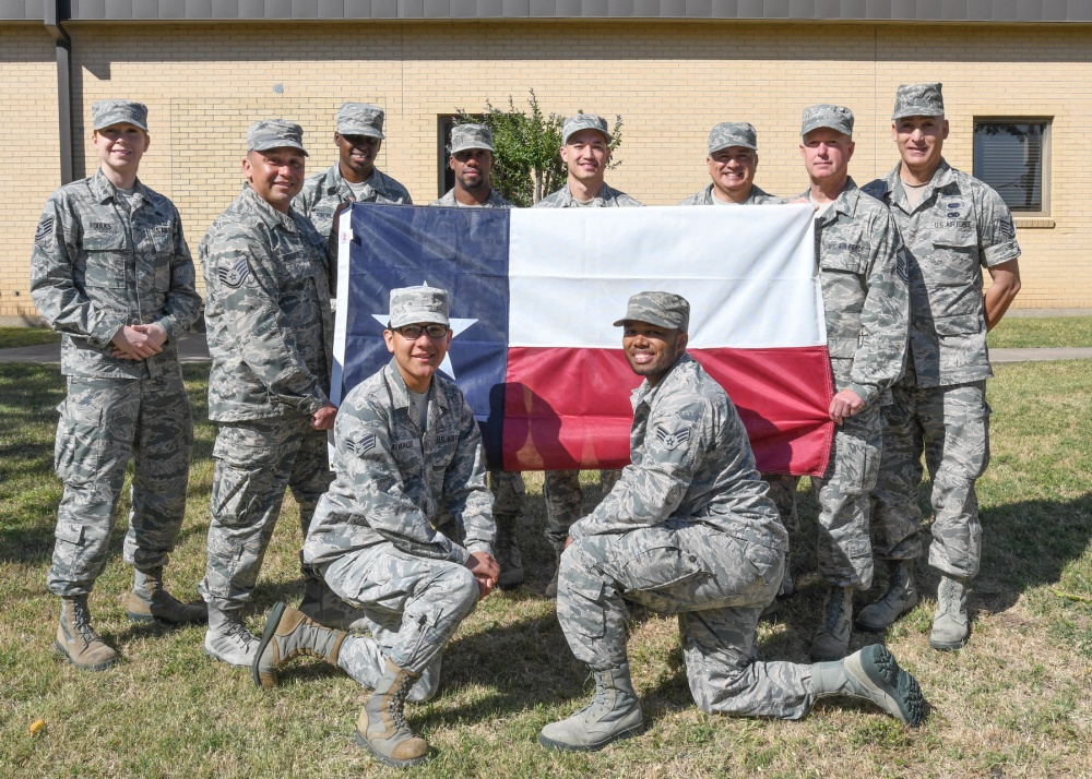 Photo By Senior Airman DeJon Williams | Members of the 272nd Engineering Installation Squadron, Ellington Field, Texas pose for a group photo May 24, 2017, at the 136th Medical Group, Naval Air Station Fort Worth Joint Reserve Base, Texas. The EIS team travelled to Fort Worth, Texas from Houston to assist the 136th Communications Flight with category-five cable installations throughout the wing. (U.S. Air National Guard photo by Senior Airman De'Jon Williams)