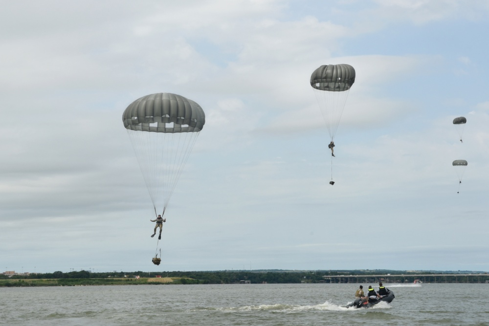 Photo By Staff Sgt. Kristina Overton | Members of the 181st Weather Flight parachute into Lake Worth after jumping out of a C-130 Hercules during a deliberate water drop in Forth Worth, Texas, May 20, 2017. The training mission was scheduled for members to practice airborne covert water parachute infiltration and included a joint effort between the Texas Air National Guard, Army, Coast Guard Auxiliary, and local fire department. (Texas Air National Guard photo by Staff Sgt. Kristina Overton)