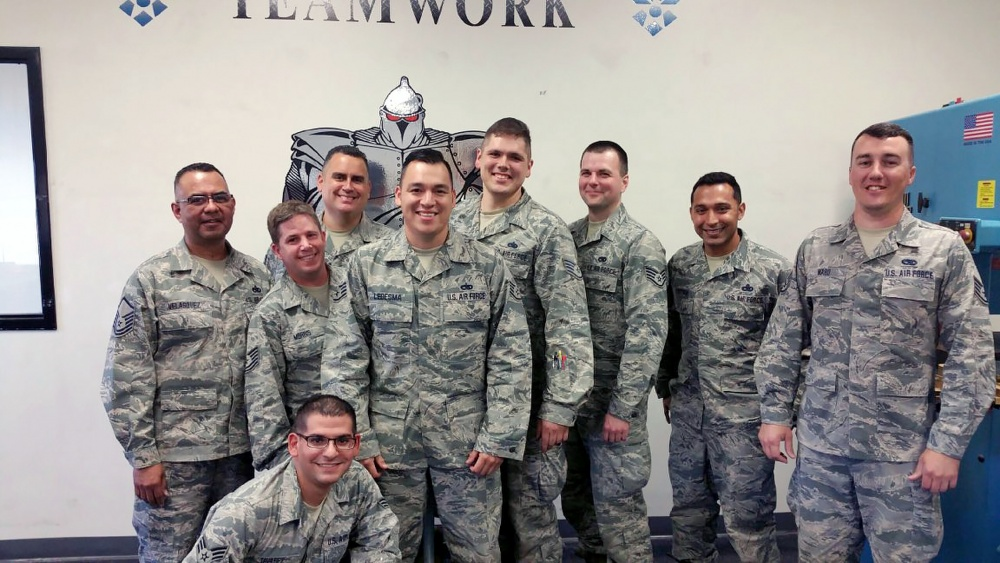 Photo By Tech. Sgt. Mindy Bloem | Staff Sgt. Nathan Ward (far right) poses for a group photo with his fellow 149th Fighter Wing members during a regularly scheduled drill weekend at his shop, headquartered at Joint Base San Antonio-Lackland, Texas. when Ward is not working as a Guardsman during his drill weekends, he serves full time as police officer in Rockport, Texas. (courtesy photo)