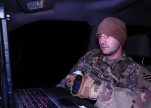 Cpl. Thomas Leroux, a Task Force-Volunteer Mobile Video Surveillance System truck commander, studies a computer screen in Rio Grande City, Texas, Dec 21, 2019. Leroux leads one of many two-man Mobile Video Surveillance System Truck teams along the Southwest Texas border. (Air National Guard photo by Staff Sgt. De'Jon Williams)
