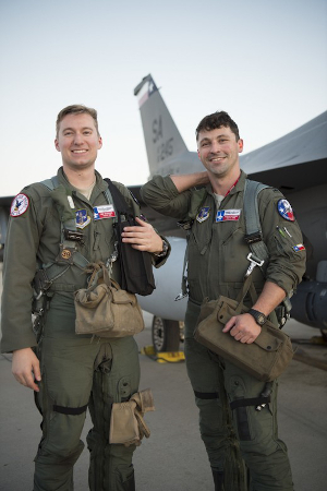 First Lt. Jared Wesemann and 1st Lt. Ian Bonner, two F-16 student pilots assigned to the 149th Fighter Wing, Texas Air National Guard, pose for a photo before take-off during Coronet Bronco, Feb. 24, 2020, at Luke Air Force Base, Ariz. The annual training event deploys members of the 149th Fighter Wing, headquartered at Joint Base San Antonio-Lackland, Texas, to another environment in order to familiarize them with accomplishing mission objectives in an unfamiliar location. (Air National Guard photo by Airman 1st Class Kaliea Green)