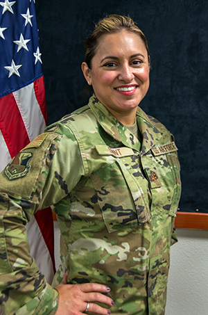 Texas Air National Guard Major Adrienne Saint, 136th Airlift Wing Logistics Readiness Squadron Officer, smiles in celebration of being cancer-free September 27, 2020, at Naval Air Station Joint Reserve Base Fort Worth, Texas. Saint recently celebrated her fourth anniversary of being breast cancer-free after a full bilateral mastectomy in September 2016. Making an effort to fully understand the experiences and recognize the resilience of those who serve alongside helps build stronger Citizen Airmen. (Texas Air National Guard photo by Airman 1st Class Laura Weaver)