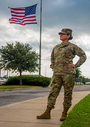 Texas Air National Guard Major Adrienne Saint, 136th Airlift Wing Logistics Readiness Squadron Officer, takes a moment to celebrate four years of being breast cancer-free September 27, 2020, at Naval Air Station Joint Reserve Base Fort Worth, Texas. After her diagnosis in 2016, Saint had five major surgeries over the span of 18 months. Understanding Citizen Airmen and their personal struggles boosts the resiliency of military and civilian Air Force members. (Texas Air National Guard photo by Airman 1st Class Laura Weaver)