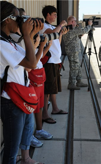 A group of Backpack Journalists take some photos Aug. 22 on an expedition to the Texas Army National Guard airfield during the 132nd National Guard Association of the United States General Conference in Austin, Texas.