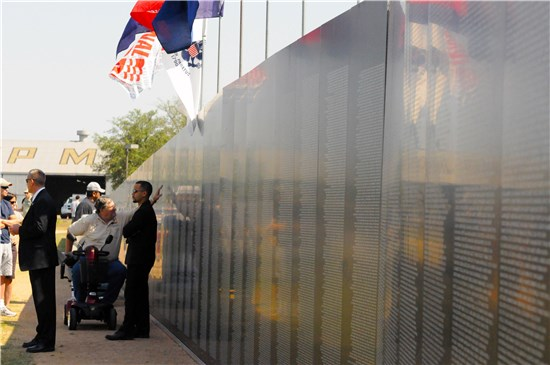Texas Military Forces, civilian and military attendees of the American Heroes Air Show paid tribute to names on the American Veterans Traveling Vietnam War Memorial on Camp Mabry Saturday, April 16.
