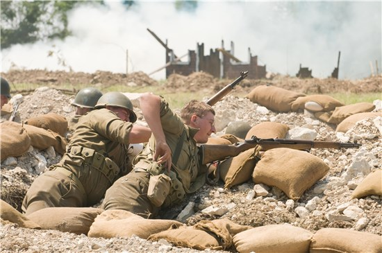 Reenactment enthusiasts recreate a battle from World War II on Camp Mabry, Austin, Texas, April 16.