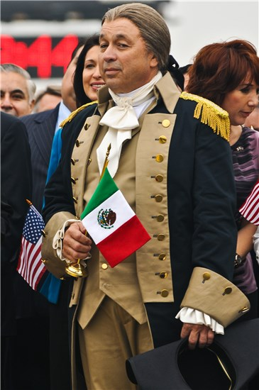 A George Washington portrayer hold a small Mexican flag to represent the unity of not only the twin sister cities of Laredo and Nuevo Laredo, but The United States and Mexico themselves in All I Want for Christmas Is New Year's Day.