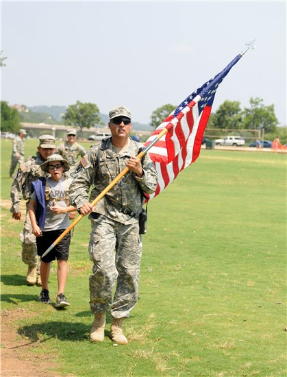 Texas Military Forces, service members, families and local civilians participate in the 5th Annual March For Fallen Heroes in Austin, Texas, May 28, 2011.