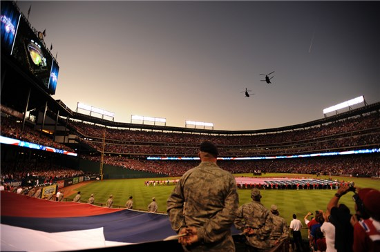 Two CH-47 Chinooks, belonging to the Texas Army National Guard, perform a two ship flyover during Game 4 of the Major League Baseball World Series between the St. Louis Cardinals and the Texas Rangers, Oct. 23, in Arlington, Texas.