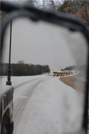 Soldiers from the 236th Engineer Company, 176th Engineer Brigade, Texas Army National Guard, head out to help fellow Texans during Winter Storm Cleon on Dec. 6, 2013.