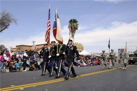 Staff Sgt. Pedro Villareal (2nd from left), along with the color guard detail from 3rd Battalion, 141st Infantry Regiment, Texas Army National Guard, participate at the 2013 George Washington Birthday Celebration Parade in Laredo, Texas, Feb. 23, 2013.