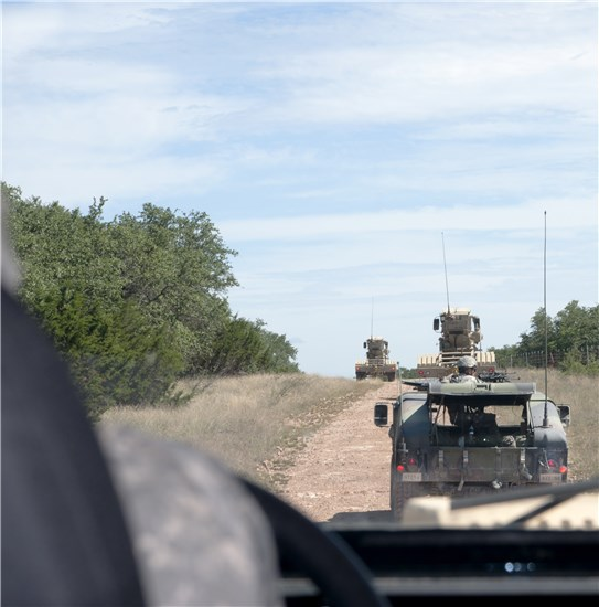 A Buffalo mine-protected vehicle follows along in a route clearance convoy training-mission at Camp Bowie in Brownwood, Texas, June 18, 2013.