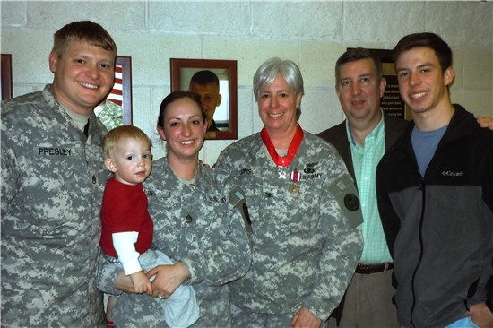 "Col. Deanne E. ""Dea"" Lins, a member of the T xas Army National Guard, stands with her family at Camp Mabry, in Austin, Texas, Jan. 12, 2013. Lins received the Meritorious Service Medal and retired after more than 30 years of service to the state and nation"