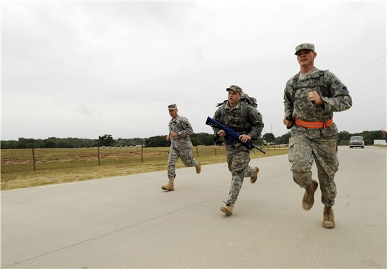 Sgt. Steven Montoya (pictured here with ruck sack), Oklahoma Army National Guard, runs to the finish line in the ruck march portion of the NGB Region V Best Warrior Competition held at Camp Swift, Texas, May 7 to 9, 2013.