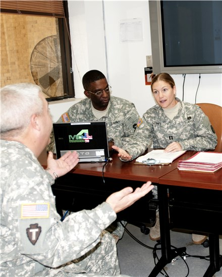 Texas Army National Guard Capt. Kimberly Spires, Medical Hold officer in charge, Texas Medical Command and Texas Army National Guard Cpl. Derrick Guy, state health systems specialist, conduct a mock medical evaluation board (MEB) for a wounded Texas Army National guardsman.