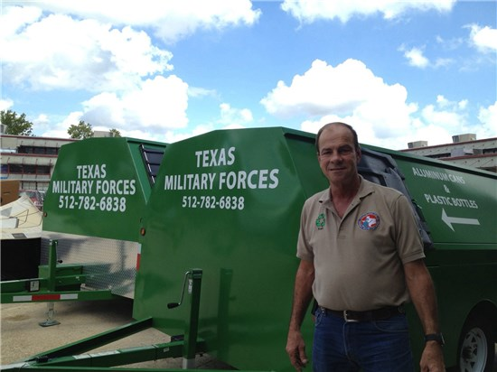 Kenneth Zunker stands in front of recycling trailers at the Texas Military Forces recycling facility on Camp Mabry in Austin, Texas.