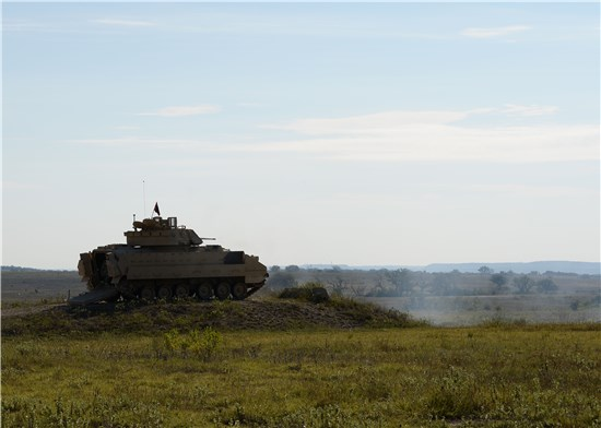 Soldiers from the Texas Army National Guard's Regional Training Institute (RTI) fire a 25mm round from a Bradly fighting vehicle at Fort Hood, Texas.
