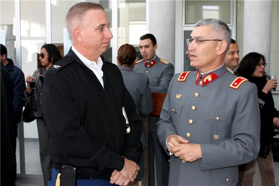 "Brigade Commander Col. Lee Schnell (left) discusses observations made during the Volcano VI emergency exercise with Chliean Army Brig. Gen. Miguel Alfonso Bellet (right), commander of the 1st Brigade ""Coraceros,"" in Arica, Chile, Aug. 20, 2014."