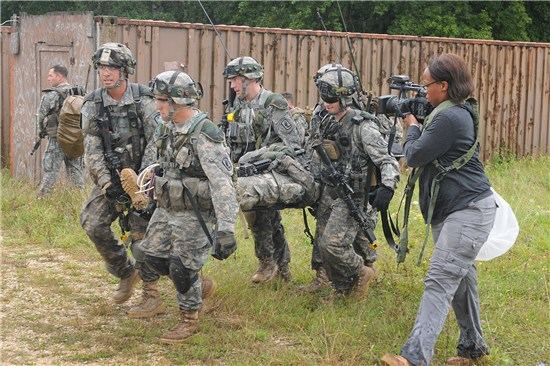 Sgt. Marlene Duncan, 100th Mobile Public Affairs Detachment, Texas Army National Guard, right, role plays as a civilian media reporter during Operation Saber Junction held at Hohenfels in Nuremburg, Germany, Sept. 10, 2014.