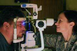 Sgt. Suzanne Carter Air Force Capt. Laura Lokey, an optometrist with 149th Medical Group, 149th Fighter Wing, checks Miguel Gomez's eyes on day four of Operation Lone Star at Manzano Middle School in Brownsville, Texas, Aug. 7, 2014. This was the first year that full vision services were available at the Brownsville medical point of distribution during this annual, five-day, medical and emergency preparedness exercise. More than 600 patients received eye exams and prescription glasses through Remote Area Medical, the Knoxville, Tenn.-based organization that provides the equipment for the exams and fills glasses prescriptions on-site, and Texas Military Forces during Operation Lone Star 2013. (U.S. Army National Guard photo by Sgt. Suzanne Carter/Released)