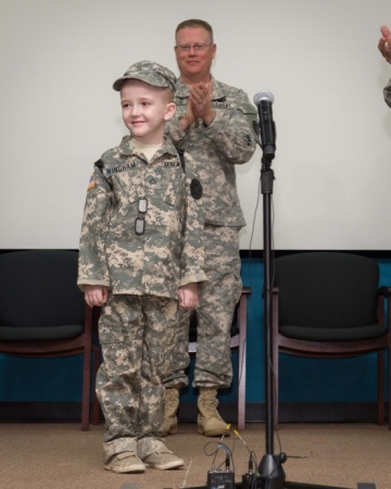 Honorary enlistee Rowan Windham poses for a picture at his honorary enlistment ceremony held at Camp Mabry in Austin, Texas, March 27, 2015. Windham is battling a rare disorder, Shwachmann-Diamond Syndrome, which affects the pancreas, gastro-intestinal tract, immune system, blood and bone marrow. During one of his stays at the Children's Hospital in San Antonio, Windham met Sgt. David Hixson, a medic with the Texas Army National Guard. There, Windham shared his dream of always wanting to be a Soldier and soon after, Hixson, with the help of fellow Texas National Guardsmen, made it all possible. (U.S. Army National Guard photo by Sgt. 1st Class Malcolm McClendon).