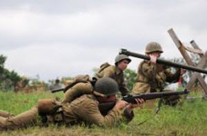 Courtesy Photo A Soldier with the 36th Infantry Division fights against enemy German Soldiers during a WWII reenactment at the Texas Military Forces Open House and Air Show at Camp Mabry April 18, 2015. Camp Mabry and its facilities are open to the public. Events like these help to form a better relationship and understanding between Texas Military Forces and the Austinites who live around the post.