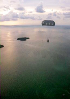 Courtesy Photo  A Texas Army National Guardsman with Special Operations Detachment - Africa, 71st Troop Command, jumps into the waters off of Key West, Fla., July 24, 2015. The jump, was part of a long-range, airborne water insertion and a culmination of three years of planning with active duty Army Special Forces, Air Force, Navy and U.S. Coast Guard to ensure that SOD-A always has trained and deployable personnel to conduct the many real world missions it is called upon to execute. (Courtesy photo by Special Operations Detachment - Africa)