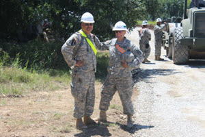 Courtesy Photo  Soldiers from the 420th Engineer Brigade pose for a photograph while participating in a 25-day roadway construction project spanning 17 miles along the perimeter of the Camp Bowie Training Center in Brownwood from July 6-30, 2015. (Texas National Guard courtesy photo by 111th Engineer Battalion/Released)