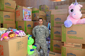 "Texas State Guard Staff Sgt. Williams, 1st Battalion, 2nd Regiment, stands amongst donated toys at Dell's Children Hospital in Austin, Texas, Dec. 19, 2015, as part of the annual ""Young Heroes of the Guard"" program. Williams led toy drive operations for 1st Battalion, 2nd Regiment and collected more than 25,000 toys to be delivered to sick children all over Texas. (Texas State Guard photo by Col. Joseph Jelinski/ Released)"