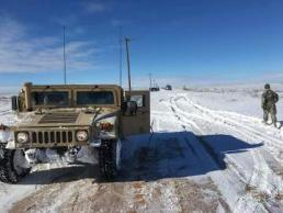 A soldier from 2nd Battalion, 142nd Infantry Regiment, 56th Infantry Brigade Combat Team, 36th Infantry Division, Texas Army National Guard responds to the southwest blizzard in the Texas Panhandle.