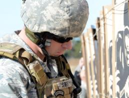 Staff Sgt. Mindy Bloem Second Lt. Brian Street, 147th Civil Engineer Squadron assigned to Ellington Field Joint Reserve Base in Houston, checks his target at the Governor's 20 Pistol Match Jan. 24, 2015, at Camp Swift, Texas