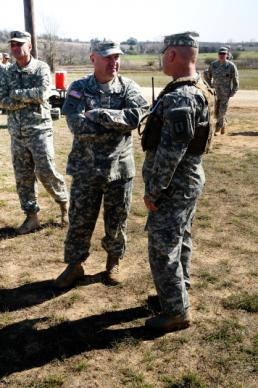 Sgt. Suzanne Carter Command Sgt. Maj. Brunk W. Conley, the Army National Guard command sergeant major, talks with the range control officer at the M203 Range at Camp Swift near Bastrop, Texas, during the 2015 Texas Military Forces Best Warrior Competition Feb. 7, 2015. Conley visited the competition to offer encouragement to competitors who each diligently trained during their off-duty days to prepare for the challenges they would face. (U.S. Army National Guard photo by Sgt. Suzanne Carter)